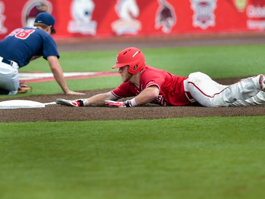 UL's Kyle Clement slides into third as the Cajuns beat Arizona 10-3 Sunday.