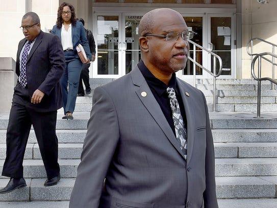 Opelousas Mayor Reggie Tatum leaves the St. Landry