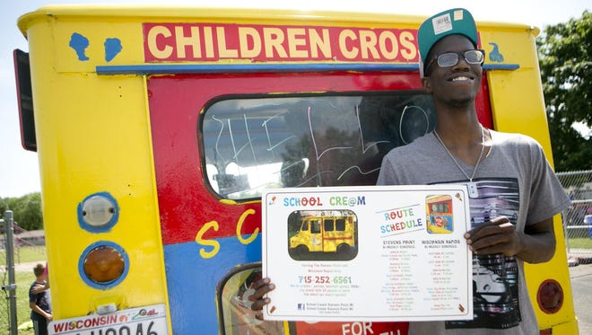 Owner of the School Cre@m ice cream truck Tavion Williams poses in front of his truck at the Boys and Girls Club in Wisconsin Rapids, Wednesday, July 15, 2015.