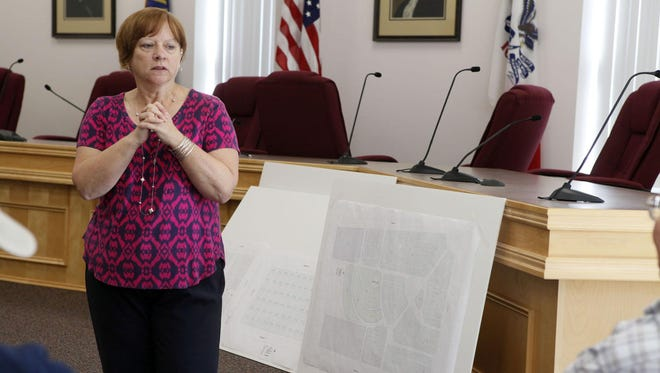Fort Madison city clerk Melinda Blind leads a meeting to recruit volunteers to help renovate the city's four cemeteries on Oct. 12. Many of the cemetery's graves are missing, unlisted or damaged. The project's goal is to create a concise and easy-to-search file of who is buried where in Fort Madison's four city-run cemeteries.