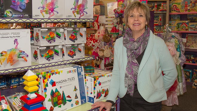 Imagine That! owner Ginny Coon features Magna-Tiles building tiles in one of display areas of her Market Street, Corning, store.