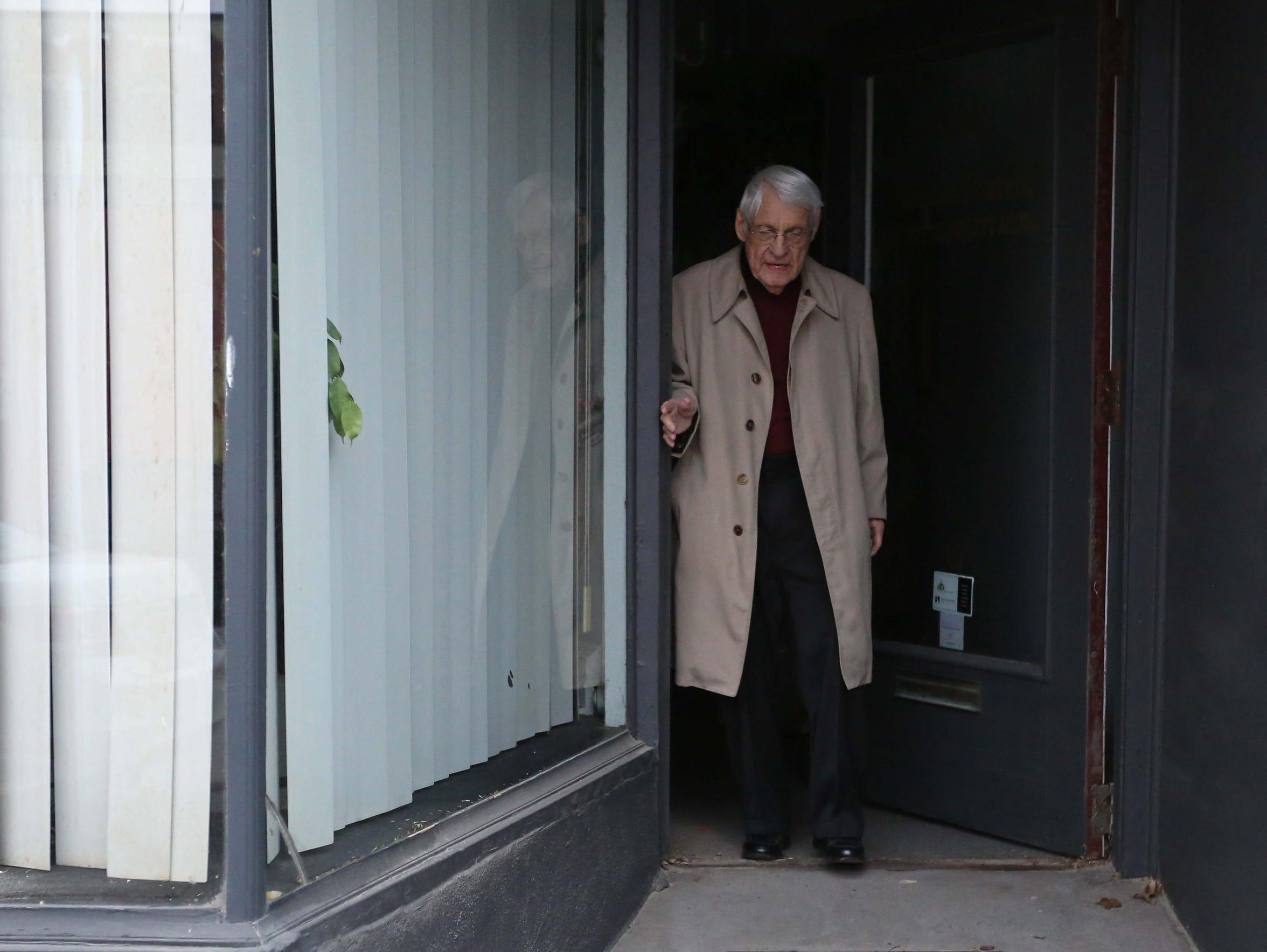 Jim Boyt walks out the doorway of his East Village