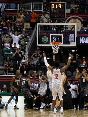 Arizona Wildcats players after guard Kadeem Allen (5) makes the winning basket.