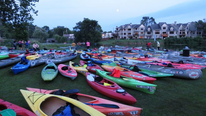 Canoeists and kayakers on the Huron River often stop at Central Park in downtown Milford during the summer.