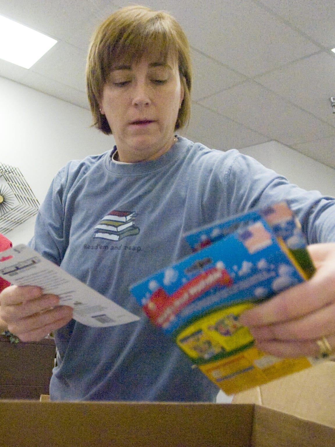Jelisa Wolfe of Staunton City Schools packages school supplies.