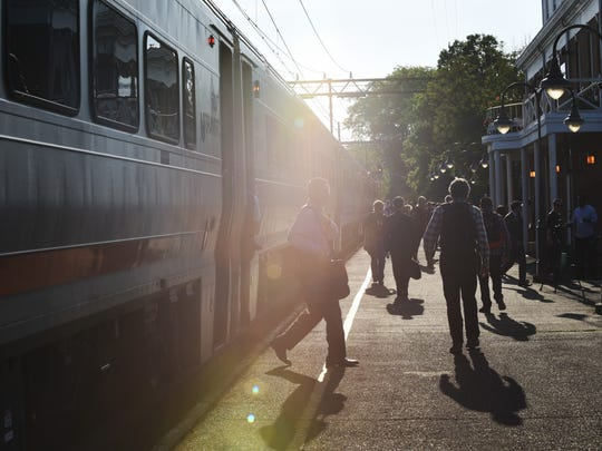 Commuters exit the train at the Millburn train station on Wednesday May 31, 2017.