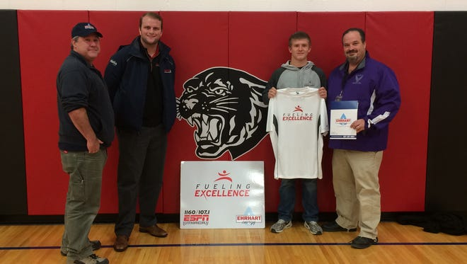 Will LeBlond from ESPN and Storn Cook from Erhart Energy honored Thomas Llewellyn as an ESPN Ithaca Fueling Excellence Athlete of the Week. Ehrhart Energy donated $50 to the S-VE Booster Club, while Tom received a t-shirt and sweatshirt, which were presented to him last week. Thomas is holding his new shirt and to the right is  SVE Athletic Director Jim Howey.