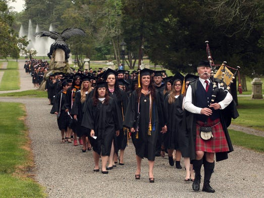 Bagpiper Joe McGonigal of Kearny leads graduates through campus during the processional at the 103rd Annual Commencement of Georgian Court University in Lakewood. May 22, 2014, Lakewood, NJ. Photo by Bob Karp