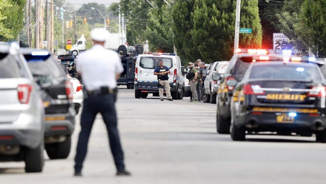 Two SWAT officers were wounded in a shooting Tuesday morning on Beulah Road in North Linden.