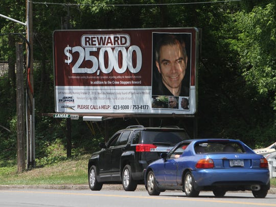 A billboard with details about the reward is posted along Route 31F in Perinton, near Baird Road.