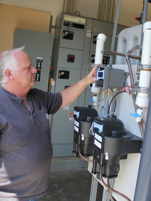 City of Gates Public Works superintendent Greg Benthin checks a gauge on the city's membrane water filtration system.