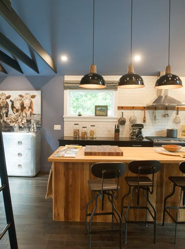 The kitchen of the HGTV Urban Oasis house in West Asheville features a custom built butcher block island for cooking. Photographed Thursday, Aug. 6, 2015.
