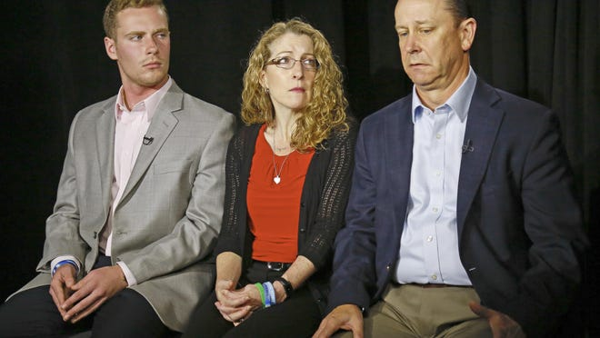 FILE – In this May 15, 2017, file photo, James Piazza, right, seated with his wife Evelyn, center, and son Michael, left, holds back emotions while discussing the death of his son, Penn State University fraternity pledge Tim Piazza, during an interview in New York. A preliminary hearing is set to resume Thursday, Aug. 10 for members of Penn State University's now-shuttered Beta Theta Pi fraternity chapter, accused in the Feb. 4 death of 19-year-old Tim Piazza, of Lebanon, N.J., after a night of heavy drinking. (AP Photo/Bebeto Matthews, File)