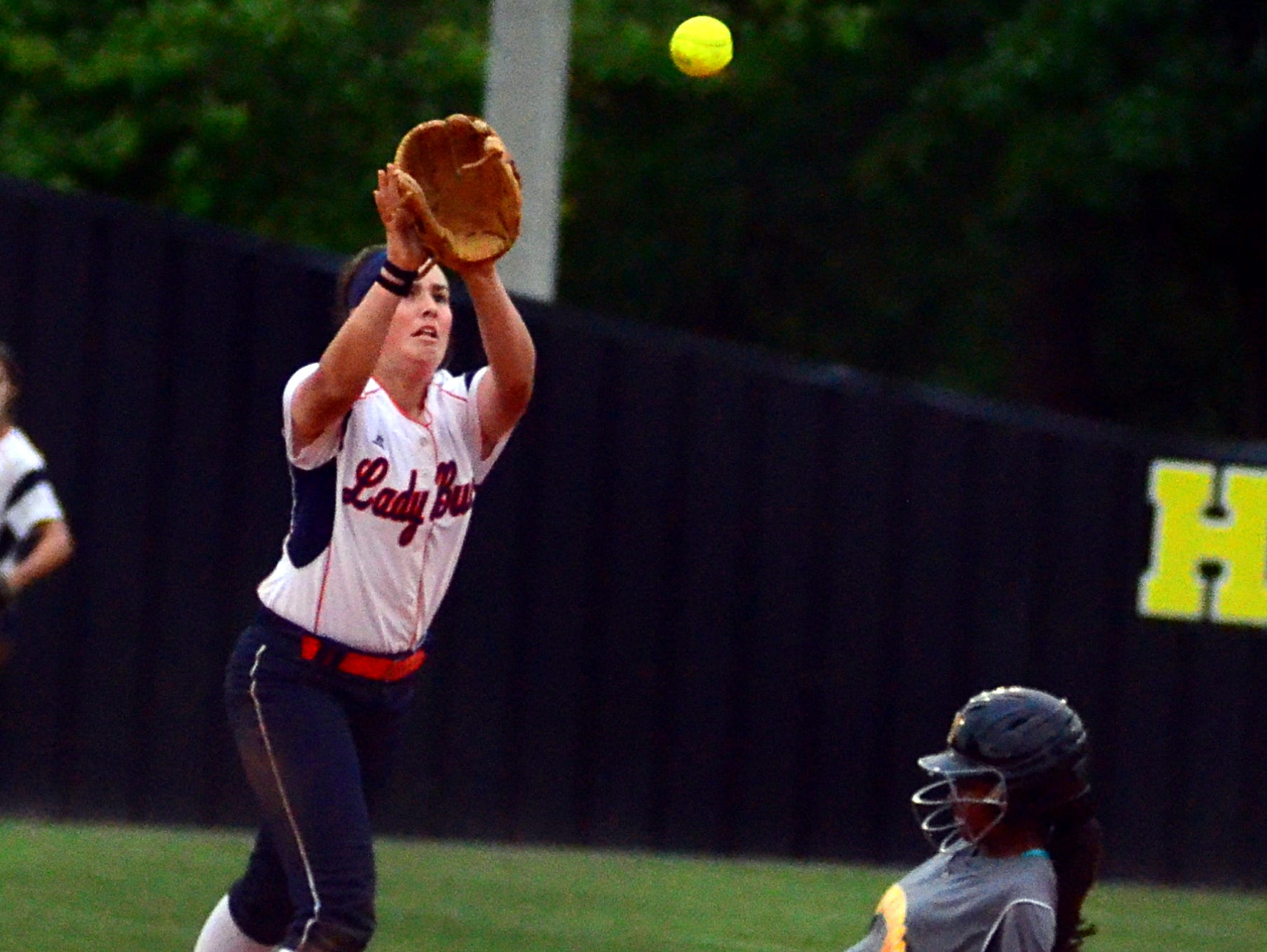 Beech High sophomore second baseman Kaylor Chaffin receives a throw as Hendersonville junior Ace Hanson slides into second base during third-inning action. Chaffin doubled and drove in a run in the Lady Buccaneers' 5-4 loss.