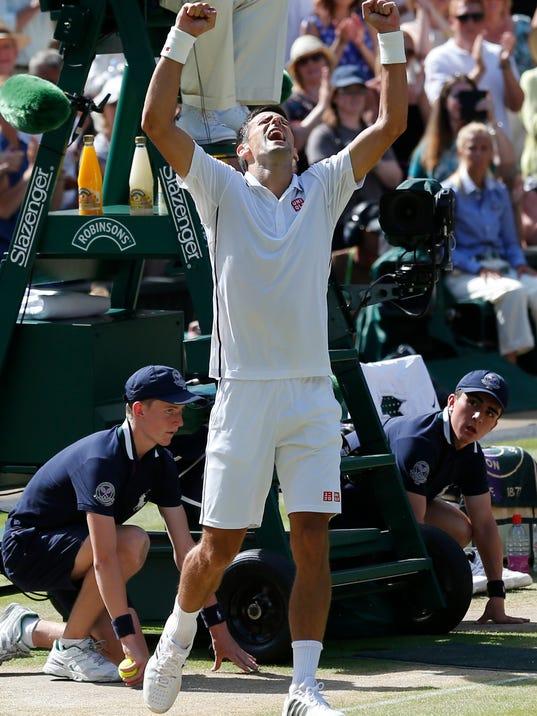 Novak Djokovic of Serbia celebrates defeating Grigor Dimitrov of Bulgaria in their men's singles semifinal match at the All England Lawn Tennis Championships in Wimbledon, London, Friday, July 4, 2014. (AP Photo/Ben Curtis)