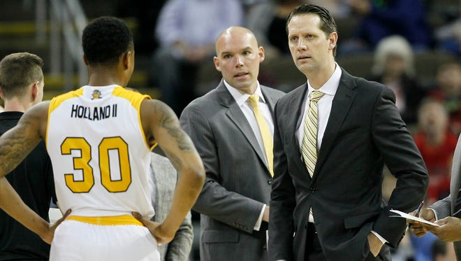 Northern Kentucky Norse head coach John Brannen brings in his team during a time out in the first half of the NCAA Horizon League basketball game between the Northern Kentucky Norse and the Green Bay Phoenix at BB&T Arena in Highland Heights, Ky., on Saturday, Feb. 10, 2018.