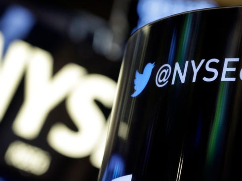 The Twitter logo is on an updated phone post on the floor of the New York Stock Exchange.