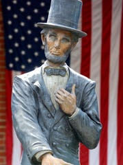 A statue of Abraham Lincoln in front of the Lincoln