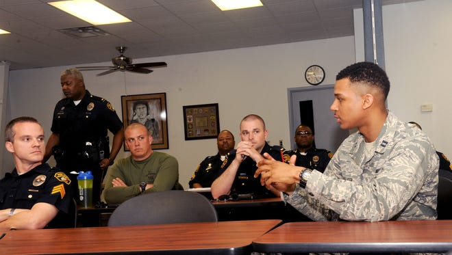 Capt. Kris Walker, right, Officer Training School chief of training, injects his perspective during a Montgomery Police Department Academy supervisory course on March 15 in Montgomery. Walker is adding an Air Force outlook to the class as well as gathering material for a leadership consortium that partners OTS and the police academy together as a way to learn from one another.