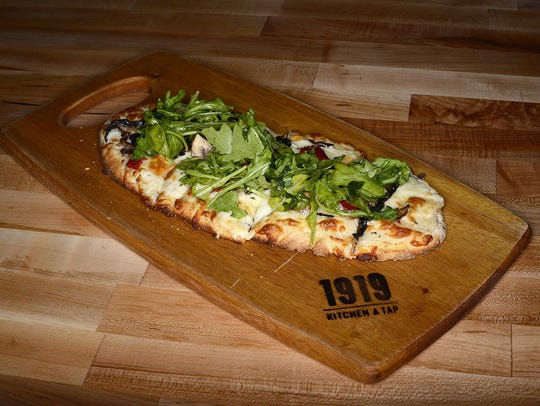 The Wild Mushroom is a pizza topped with garlic sour