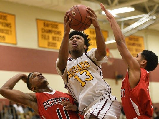 PICTURE OF THE WEEK: Washington's Shakur Cottman braces for contact while driving the lane against two James M. Bennett defenders Monday night. Cottman reach the 1,000 career point and scored 39 as the Jaguars easily dispatched the Clippers 111-83.