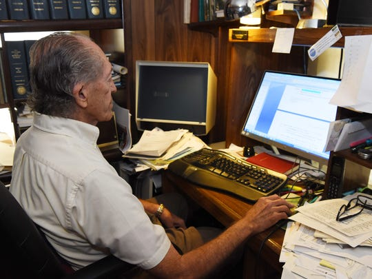 Frank Doherty, a LaGrange-based historian, works on an entry in his home office.