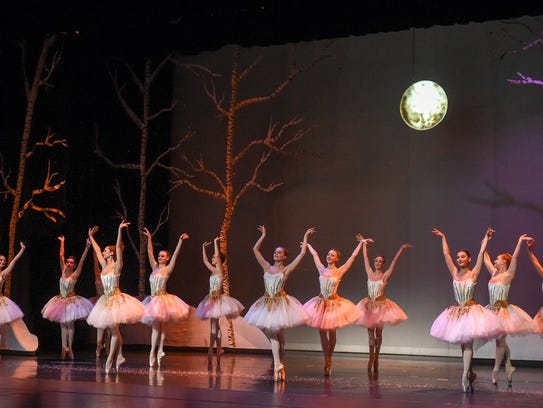 "Members of Ballet Vero Beach run through a full dress rehearsal Dec. 28 of ""Nutcracker on the Indian River"" at the Vero Beach Performing Arts Center at Vero Beach High School. Although there were sugar plum fairies, the ballet also included Florida creatures such as manatees, dolphins, sea turtles and pelicans."