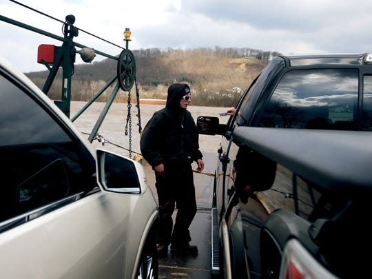 Brandon Ingram of Hebron, takes payments from automobiles aboard the Anderson Ferry before crossing the Ohio River to Cincinnati Thursday March 2, 2017. Ingram has been a deckhand for The Anderson Ferry for two and a half years. The Anderson Ferry which is on the National Register of Historic Places, celebrates its 200th anniversary this month.