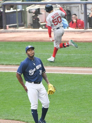 Brewers closer Neftali Feliz reacts after giving up a three-run homer to Red Sox rightfielder Mookie Betts in the ninth inning at Miller Park.