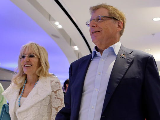 Miami Marlins owner Bruce Sherman and his wife Cynthia,