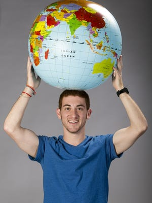 World traveler and Arizona native Drew Binsky poses for a portrait on June 8, 2016, in Phoenix. By 24, he had visited more than 70 countries in just over two years.