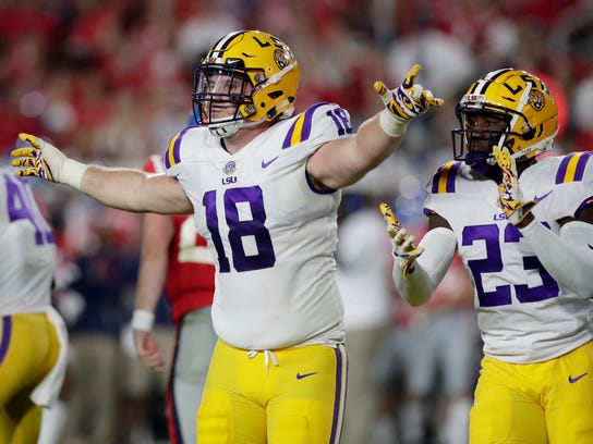 FILE - In this Oct. 21, 2017, file photo, LSU defensive end Christian LaCouture (18) celebrates his tackle of Mississippi quarterback Shea Patterson, unseen, in the first half of an NCAA college football game in Oxford, Miss. Texas A&M is the last team between LSU and the Tigers' best record in the Southeastern Conference since 2012. A victory in Tiger Stadium would give No. 19 LSU a 6-2 SEC record while improving the Tigers' bowl prospects. (AP Photo/Rogelio V. Solis, File)