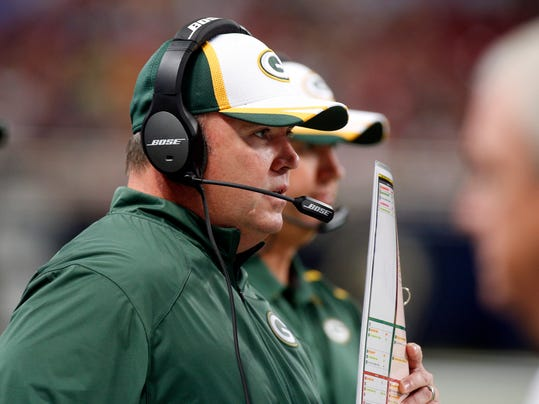 FILE - In this Aug. 16, 2014, file photo, Green Bay Packers head coach Mike McCarthy watches from the sidelines during the first quarter of an NFL preseason football game against the St. Louis Rams in St. Louis. The injury bug has hit the Packers again with two starters going down, but coach McCarthy has vowed to move forward.(AP Photo/Scott Kane, File)
