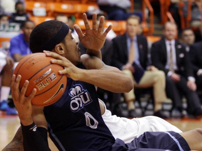 Old Dominion's Jordan Baker looks to pass, from a seated position, during a second half scramble against Middle Tennessee in their NCAA college basketball Conference USA tournament game, Thursday, March 13, 2014, in El Paso, Texas.