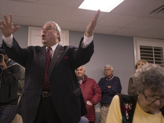 Alabama Representative Dimitri Polizos voices his opinion at a town hall meeting at Eastmont Baptist Church in Montgomery, Ala., on Tuesday, Dec. 9, 2014. The event was held to discuss a planned Walmart to be built on Bonnie Crest Country Club.