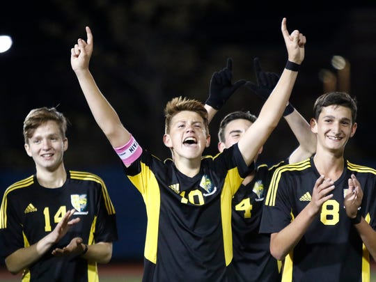 Hastings' Andrea Russo (10) celebrates after their