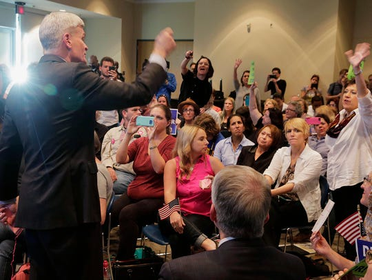 Sen. Bill Cassidy tries to pick a member among a crowd