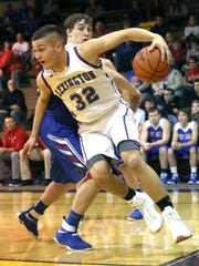 Lexington's Cade Stover swoops the ball around a West Holmes player while playing a home game Tuesday night.