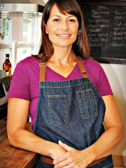 Carrie Sullivan, owner of The Gathering Table in downtown Melbourne.