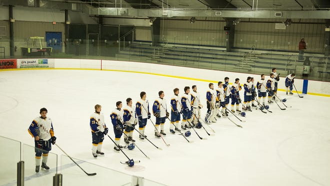 Milton lines up for player introductions during the boys hockey game between Stowe and Milton at Cairns Arena on Wednesday night in South Burlington.
