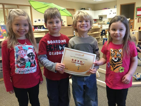 Students at Jesus' Little Lambs celebrate the four-star rating of the child care service.
