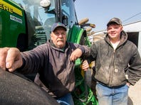 In this April 17, 2018 photo Ted Kreke, left, and his son John farm ground in Teutopolis, Ill. John  plans to take over the family farm once he finishes his studies at Lake Land College and then at Southern Illinois University in Carbondale.