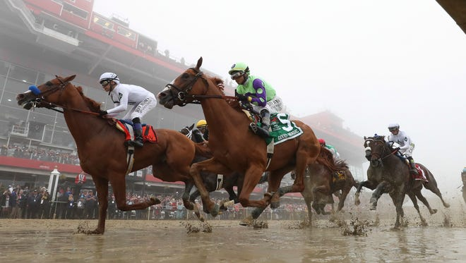 The Preakness field makes the first pass by the grandstand at Pimlico.  Justify, left, with Mike Smith aboard, holds on to win the Preakness Stakes and the second leg of the Triple Crown.