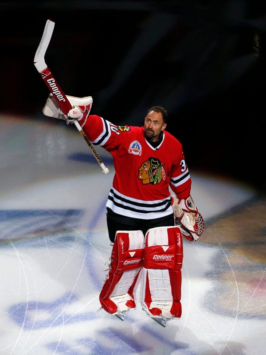 Former Chicago Blackhawks goaltender Ed Belfour waves to fans before the Dallas Stars play against the Chicago Blackhawks in an NHL hockey game Thursday, March 23, 2017, in Chicago. (AP Photo/Nam Y. Huh)