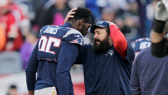 Patriots defensive coordinator Matt Patricia, right, speaks to defensive end Chandler Jones before a divisional playoff game against the Chiefs, Jan. 16, 2016 in Foxborough, Mass.