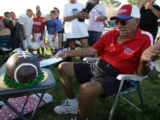 Juan Gonzalez was surprised with a football cake during T-Bird practice at Golden Key Park to mark the fiftieth anniversary of the football organization.