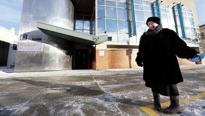 Anti-abortion protester Eleanor McCullen stands at the edge of a buffer zone outside a Planned Parenthood abortion clinic in Boston.