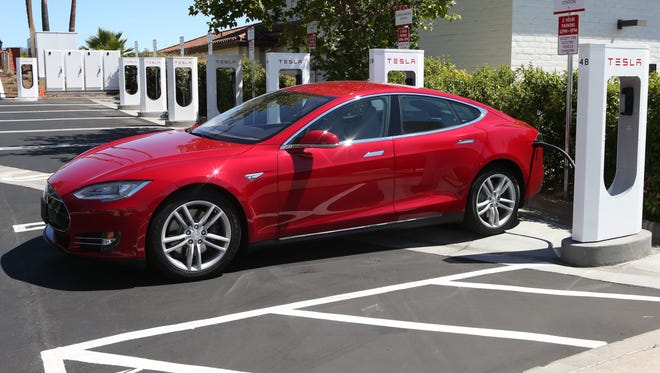A Tesla Model S electric sedan at the brand's Supercharger station in Buellton, Calif.