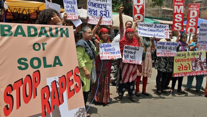 Members of All India Mahila Sanskritik Sangathan shout slogans as they protest against increasing number of rape and other attacks on women and girls in the country, in Ahmadabad, India, Thursday, June 19, 2014. A village council in India was accused Friday, July 11 of ordering the rape of a 14-year-old girl.