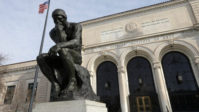 In a photo from Tuesday, Dec. 10, 2013, at the Detroit Institute of Arts in Detroit, The Thinker, a sculpture by Auguste Rodin is seen outside the art museum.